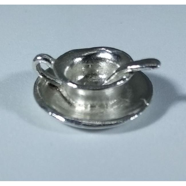 Чашка на блюдце серебряная