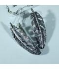 Серебряные серьги перья